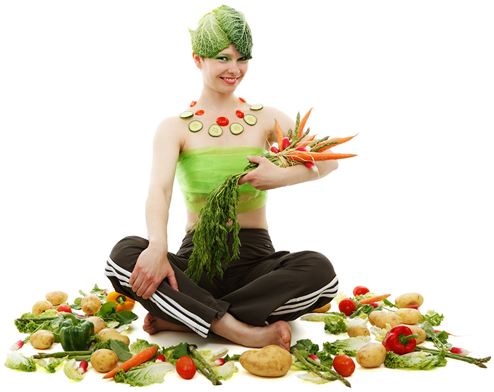 woman decorated with food and food all around her